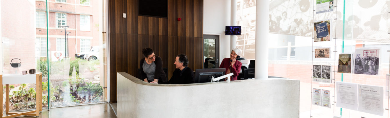 Image: Three people at desk