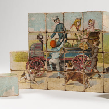 A photograph of a 19th century children's block puzzle
