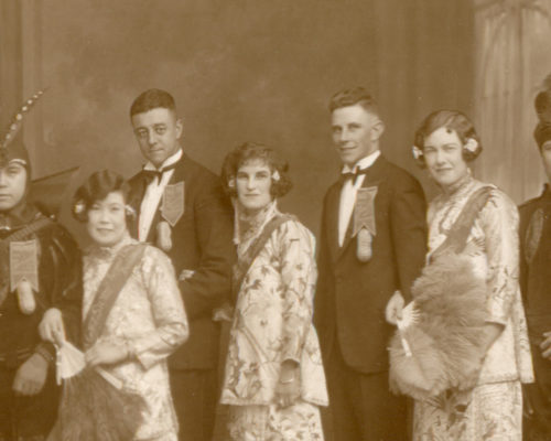 Gladys and Gordon Sym Choon lead a group of eight, promoting the Sym Choon shops